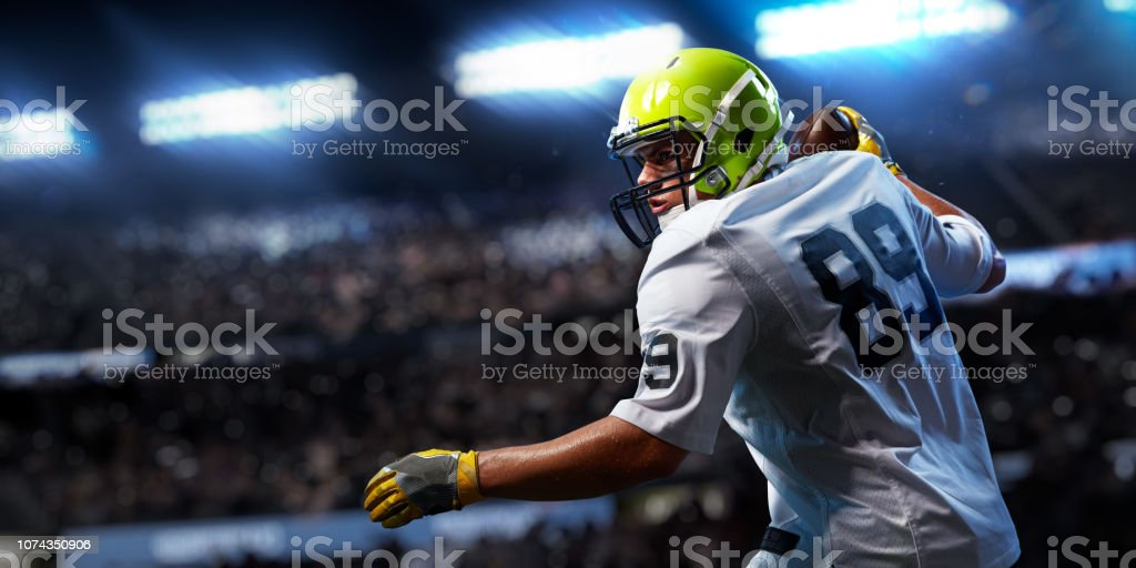 American football sportsman player on stadium in action. Sport...