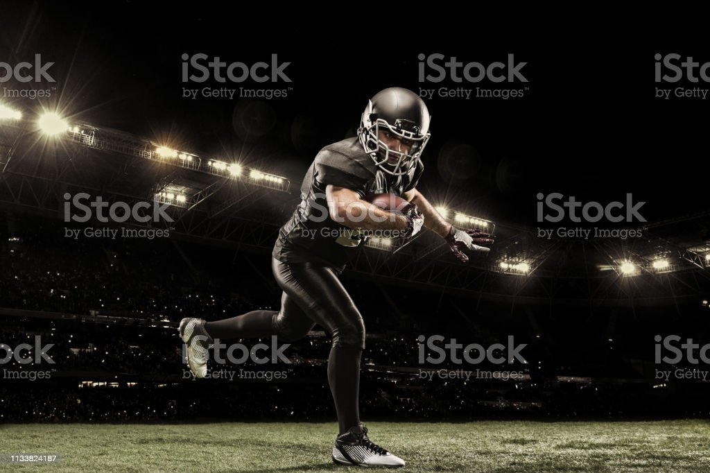 Professional american football player on stadium running in action....