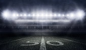 istock American football stadium in lights and flashes 543836212