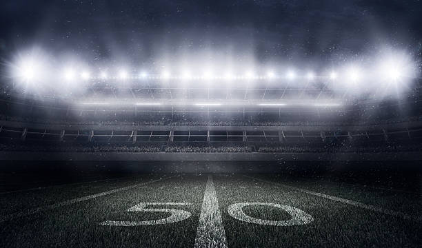 american football stadium in lights and flashes - amerikanischer football stock-fotos und bilder