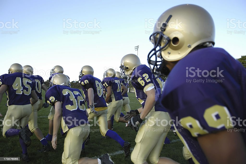 American Football team takes the field royalty-free stock photo
