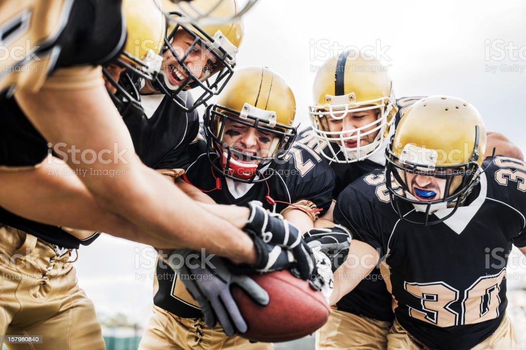 American Football teamwork. stock photo