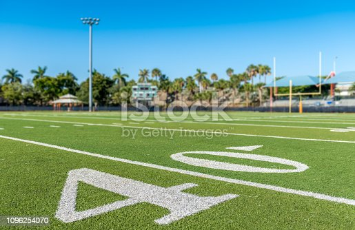 Football stadium 40 yard line artificial grass and markings.