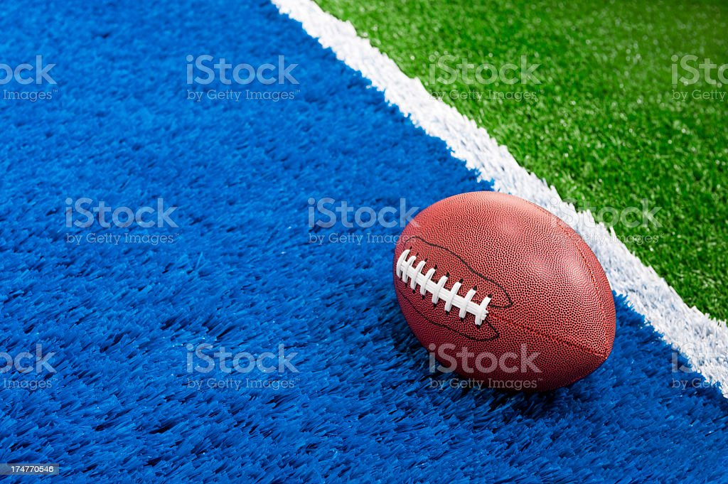 American Football - Touchdown with ball in the end zone stock photo