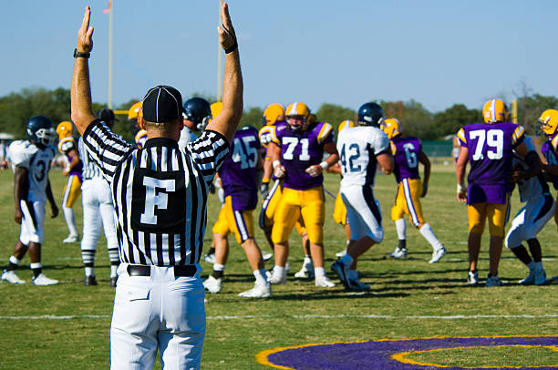 American Football - Touchdown with offcial American Football played by young men scoriing a touchdown signaled by game official line of scrimmage stock pictures, royalty-free photos & images