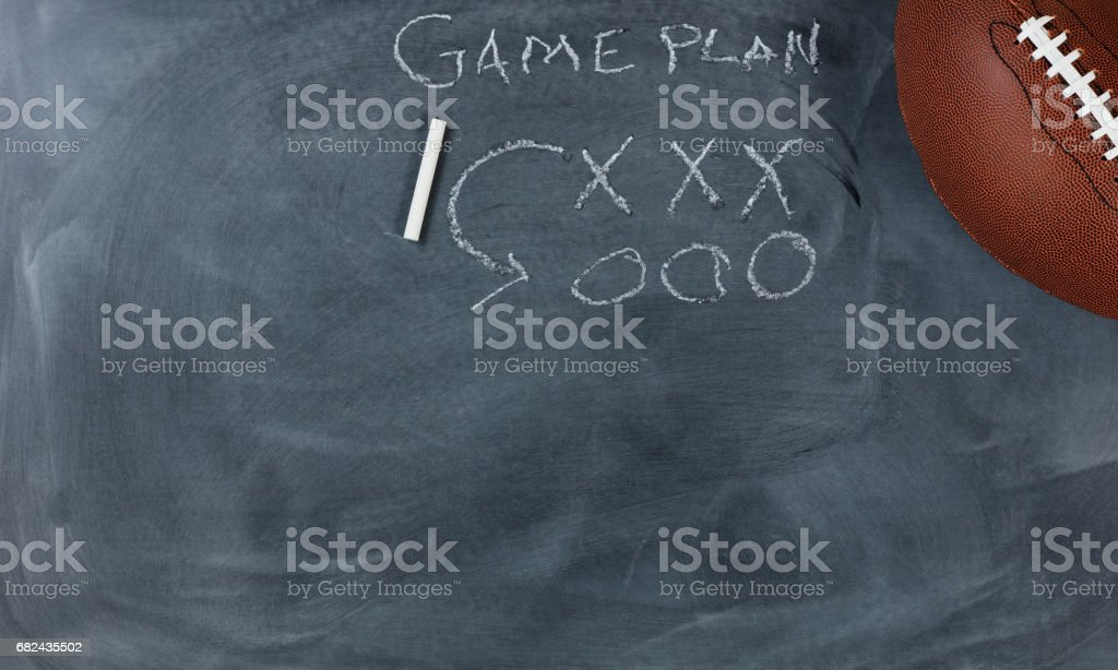 American football with game plan on chalkboard setting royalty-free stock photo