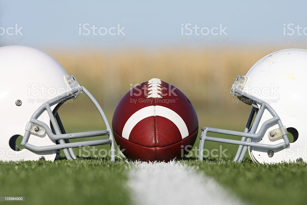 American Football with Helmets on the Field stock photo