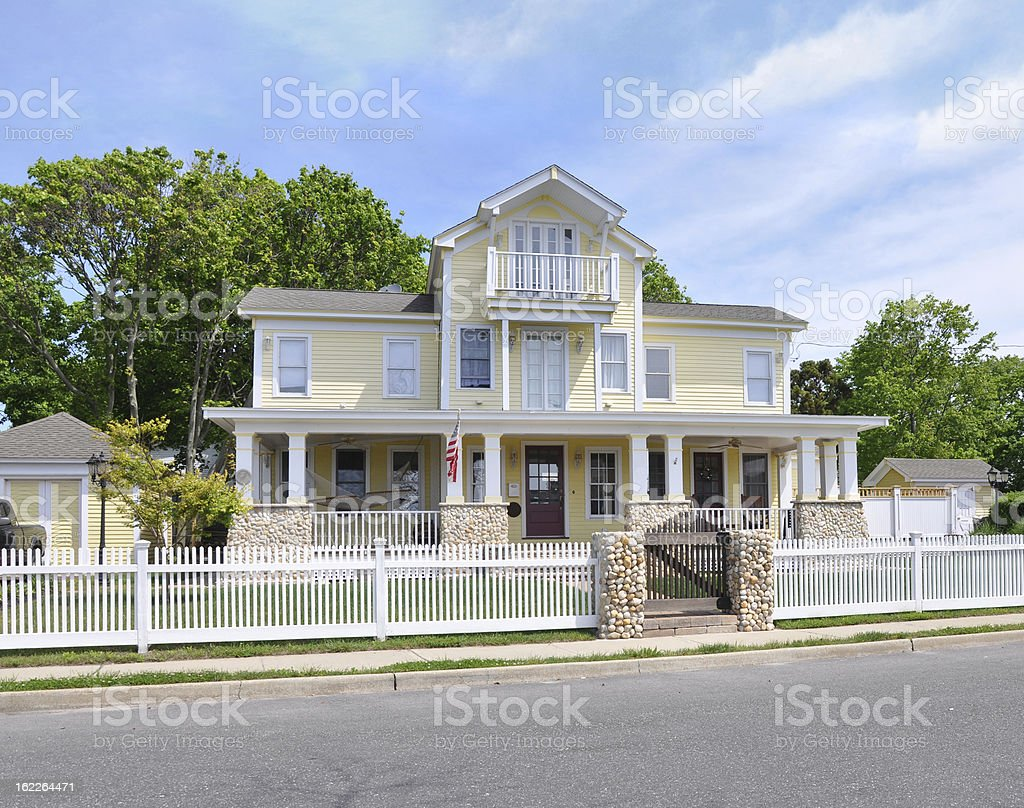 American Four Square Colonial McMansion Style Home White Picket Fence stock photo