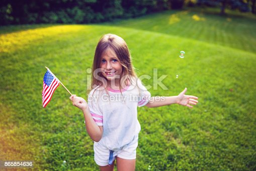istock American Girl with a Flag 865854636