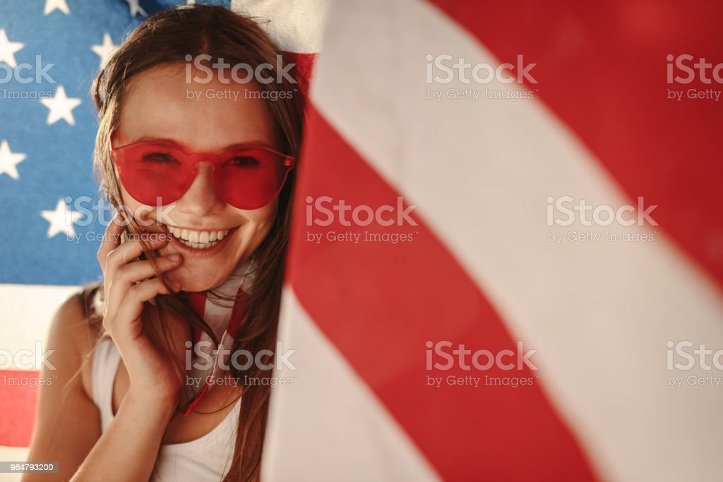 American girl with national flag stock photo