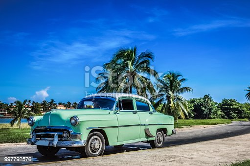 HDR - American green vintage car with a white roof in Varadero Cuba - Serie Cuba Reportage