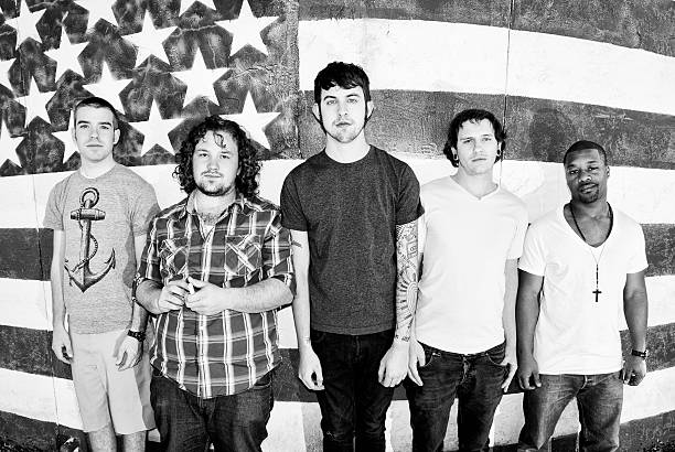 American Guys (black and white) A group of young men in their early 20's in front of an American flag.  Linearly corrected fisheye image. american flag tattoos for men stock pictures, royalty-free photos & images