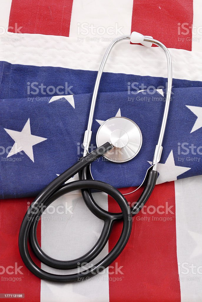 American Health Care Medical Stethoscope on folded American Flag for US Health Care concepts American Flag Stock Photo