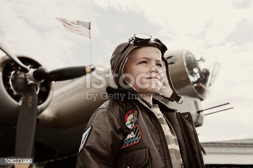 A young boy is thankful for freedom in front of a B-17 Bomber. In honor of the veterans of WWII. Image taken on the 4th of July.