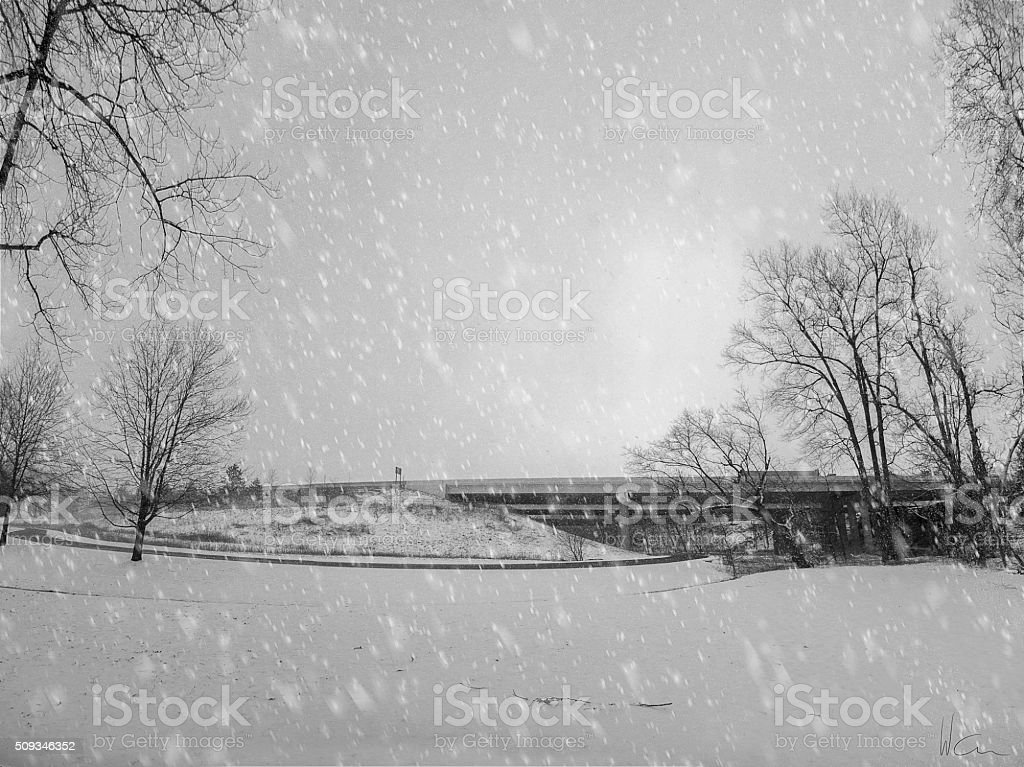 American Highway and Snow Falling stock photo