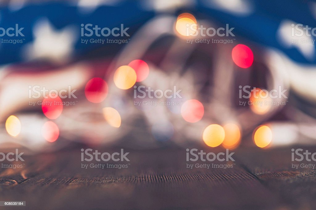 American holiday background with US flag and Christmas lights stock photo
