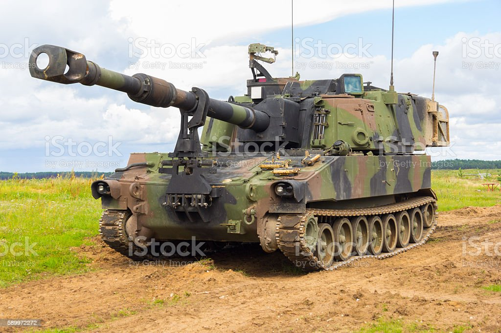 american howitzer stands on a battlefield stock photo