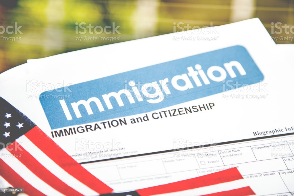 American immigration, citizenship forms with USA flag. stock photo