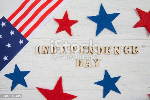 istock American Independence day background. Text, stars and USA flag 1137110445