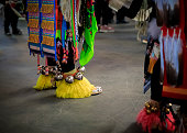 istock American Indian dancers in handmade beaded leather moccasins decorated with jingle bells at a powwow in San Francisco 1263109723