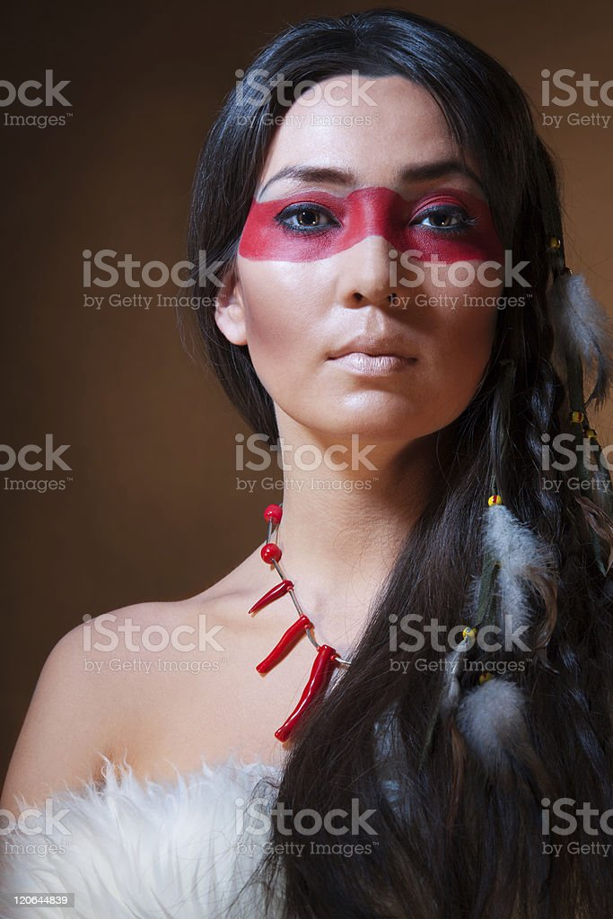 American Indian with face camouflage royalty-free stock photo