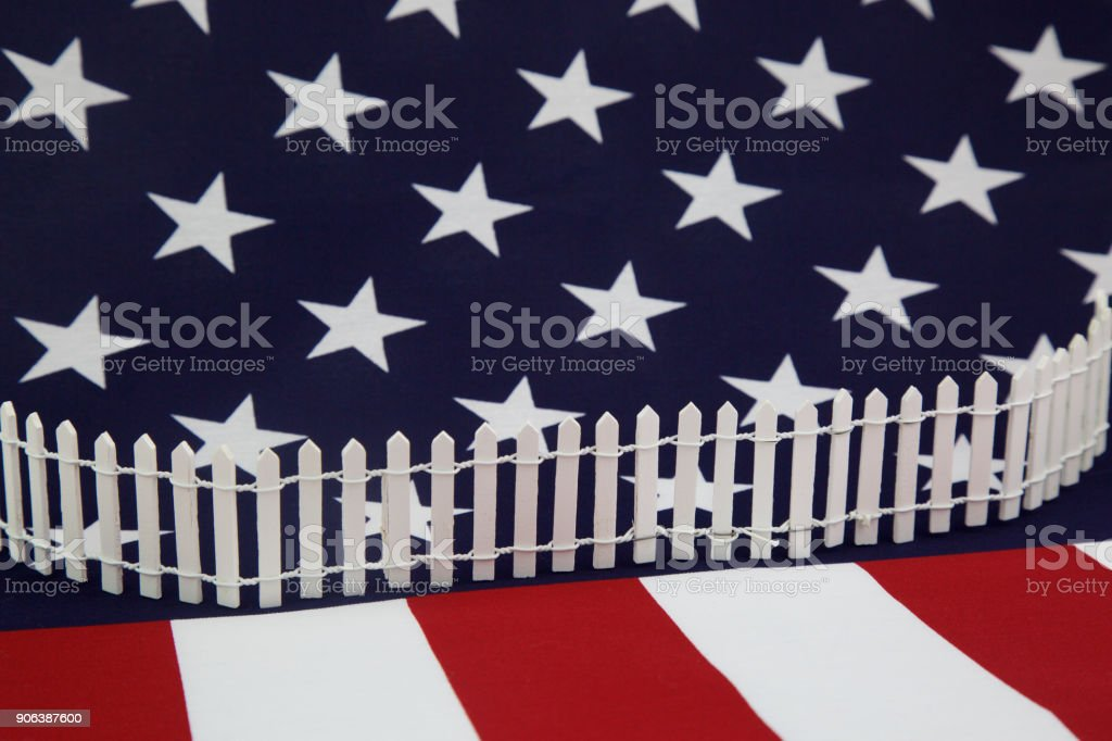 american isolationism - fence across the united states flag stock photo