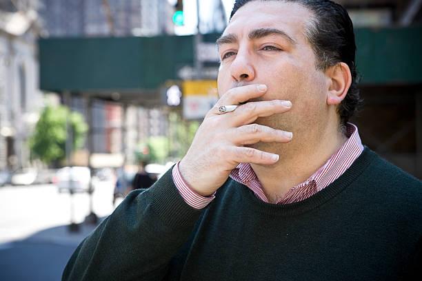 American Italian Man Portrait, Smoking on City Sidewalk, Copy Space stock photo