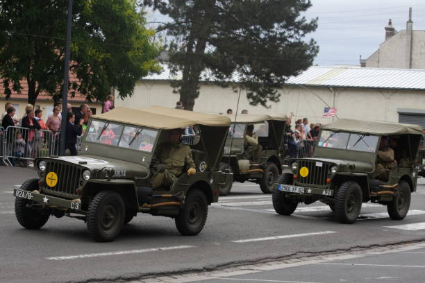 American jeep of the Second World War parading for  commemorating the French Revolution American jeep of the Second World War parading for the national day of 14 July commemorating the French Revolution. Saint-Quentin in Aisne, Picardie region of France willys stock pictures, royalty-free photos & images