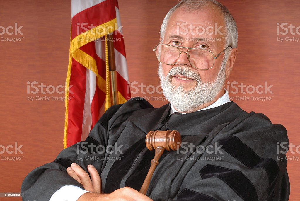 American judge Portrait of a senior judge with an American flag and expendable copy space to both sides Active Lifestyle Stock Photo