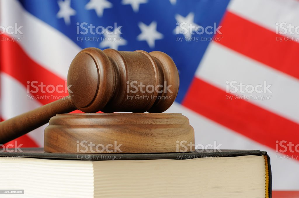 American justice - gavel on book with USA flag background stock photo