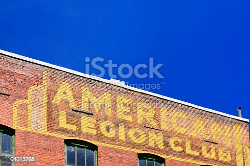 American Legion Club in yellow painted on the side of a brick building in Bisbee, AZ