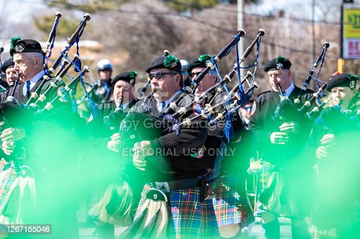 Wantagh, New York - March 17, 2019 : American Legion Wantagh Pipe Band marching in the first Annual St. Patrick's Day Parade. Long Island