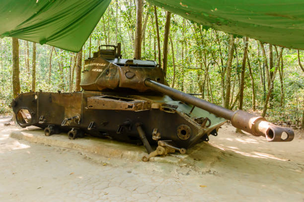 American M41 tank which was destroyed by a Viet Cong delay action mine in the jungle, 1970. Vietnam. American M41 tank which was destroyed by a Viet Cong delay action mine in the jungle, 1970. Vietnam. viet cong stock pictures, royalty-free photos & images
