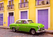 old vintage car in the malecon of cienfuegos in a sunny day. Cuba
