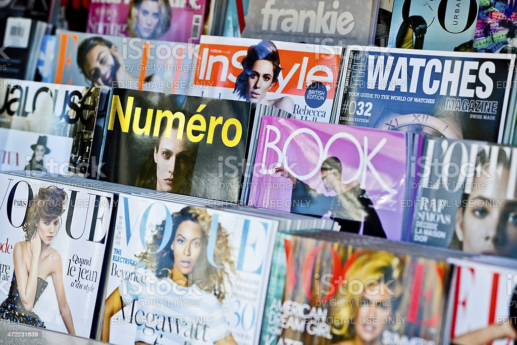 American Magazines displayed for sale on newsstand stock photo