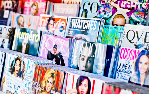 Los Angeles, USA -  May 15, 2013: American Magazines displayed for sale on newsstand in Los Angeles, USA
