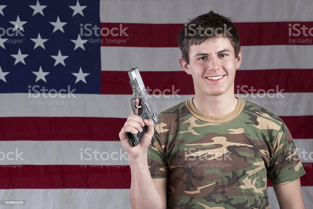American Male Armed with Hand Gun stock photo