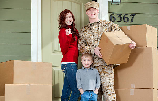American Marine Corps Soldier & Family Moving into New Home stock photo
