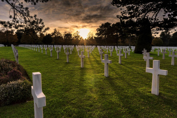 American Military Cemetery, Normandy, France The sun sets on the American Military Cemetery, Colleville-sur-Mer, Normandy, France normandy stock pictures, royalty-free photos & images