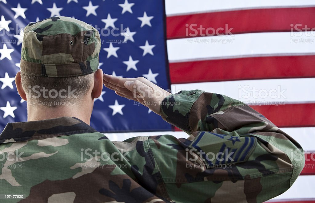 American Military Salute Against US Flag royalty-free stock photo