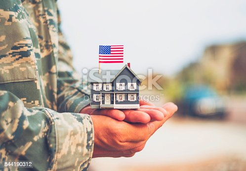 istock American military soldier with house. Relocation theme 844190312