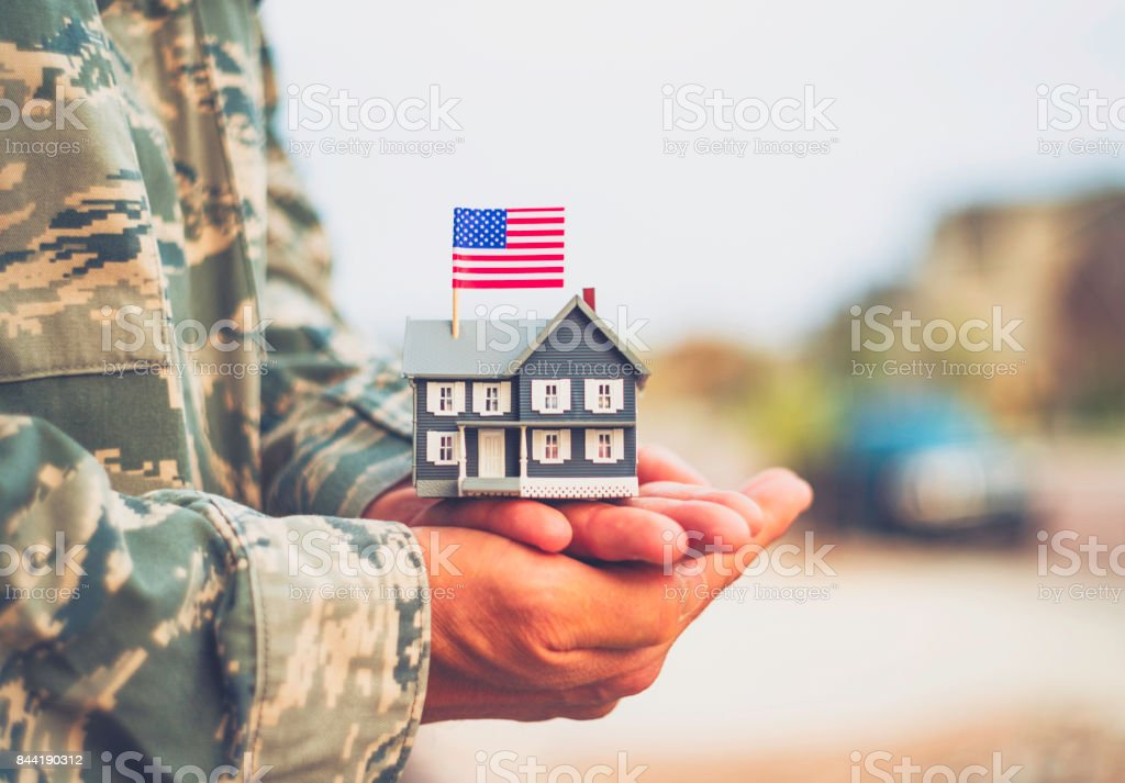 American military soldier with house. Relocation theme stock photo