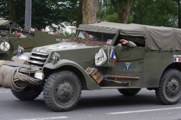 American military vehicle of the Second World War parading for  commemorating the French Revolution American military vehicle of the Second World War parading for the national day of 14 July commemorating the French Revolution. Saint-Quentin in Aisne, Picardie region of France willys stock pictures, royalty-free photos & images