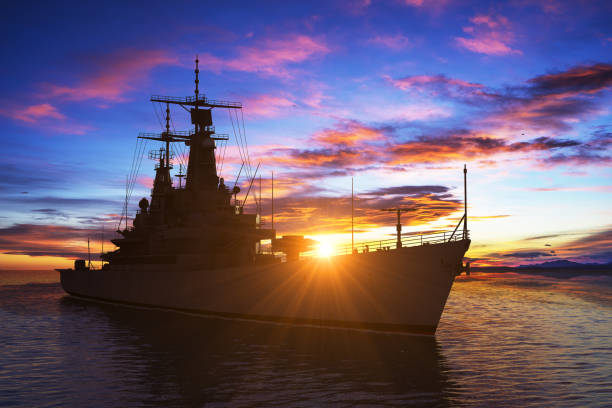american modern warship on the background of sunset - navy stock photos and pictures