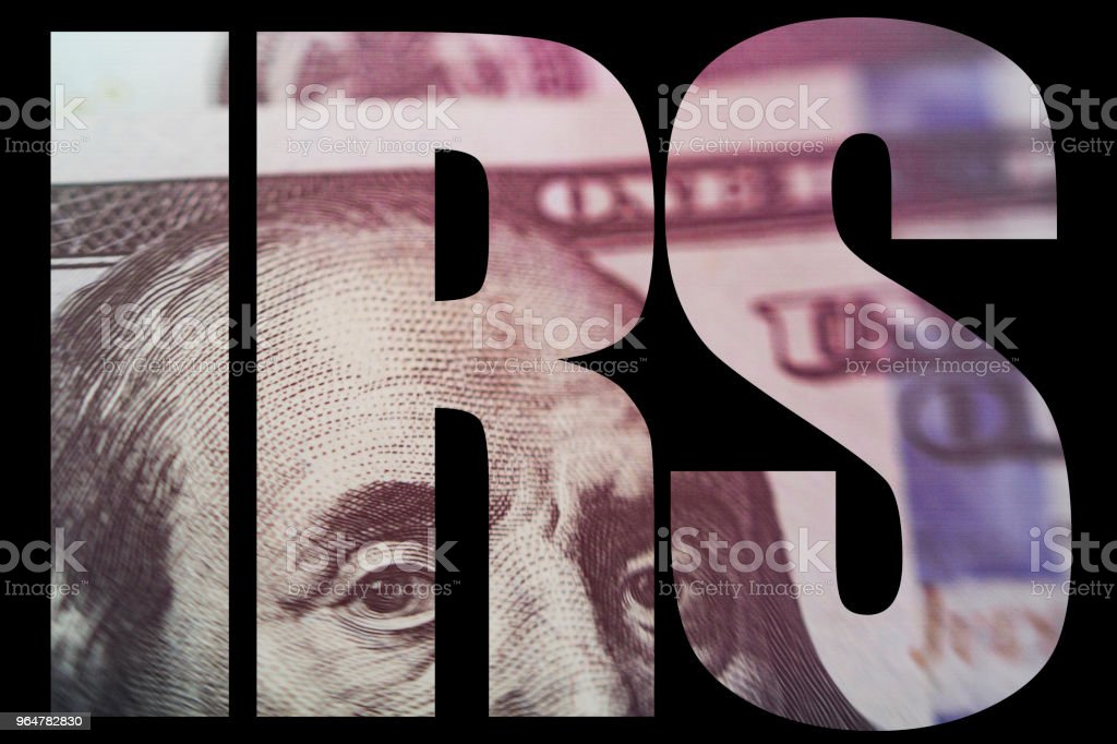 IRS, American Money Macro close up of Ben Franklin's face on the US 100 dollar bill royalty-free stock photo