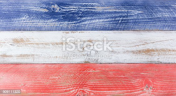 509111320 istock photo American national colors painted on fading wooden boards 509111320