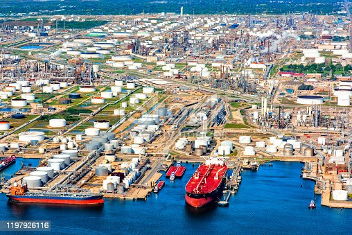 Directly above a seaport and oil refinery in Texas City, Texas, located just south of Houston on Galveston Bay where two large oil tankers are being filled.
