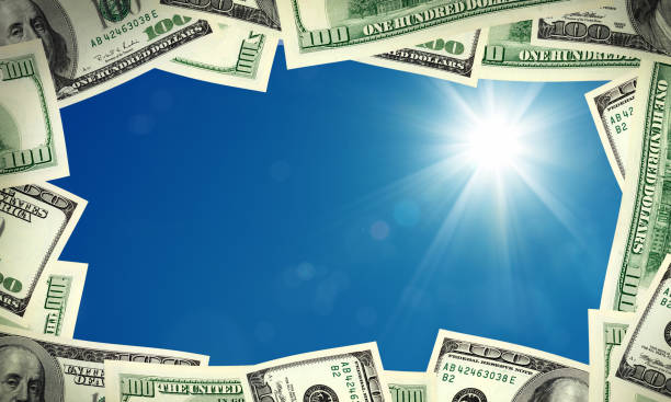 American one hundred dollar bill frame over sunny blue sky stock photo