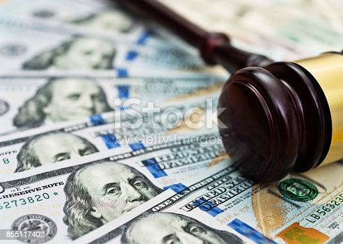 istock American one hundred dollar bills and gavel 855117402