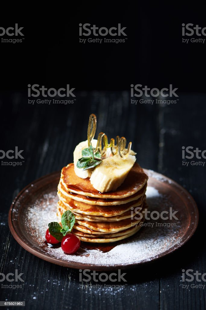 American pancakes on a plate with banana, cherry and mint royalty-free stock photo